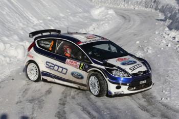 Jarmo Lehtinen guides Mikko Hirvonen through the snow in a Ford