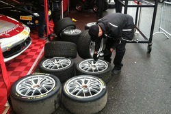 AGM crew member Daryl Cameron does a tire check