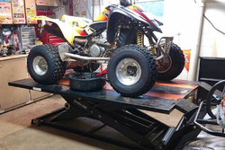 Suzuki Quad Sport on the Elevator 1800U ATV UTV Lift Table