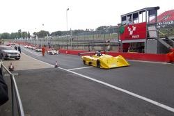 Oscella in the pit  lane