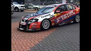 Brett Stewart's Holden charges towards the car of  Josh Kean after the Dunlop Series race 2